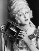 Portrait of a young woman holding one of the first telephones — Stock Photo
