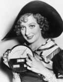 Portrait of a young woman in a hat holding a newly invented speedometer — Stock Photo