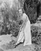 Young woman doing gardening in her backyard — Stockfoto