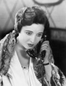 Young woman on the telephone — Stock Photo