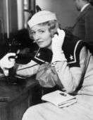 Young woman in a sailors uniform on the telephone — Stock Photo
