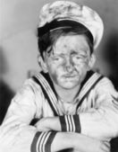 Boy in his sailors outfit with dirty face — Stock Photo