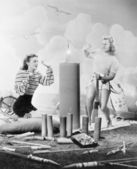 Two women sitting around fire works — Stock Photo
