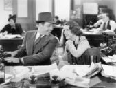 Man and woman together in the office flirting with each other — ストック写真