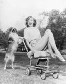 Young woman and her pushy pet dog — Foto de Stock