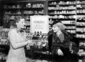 Two women in a drug store looking at each other — Stock Photo