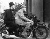 Two men riding a motorbike — Stock Photo