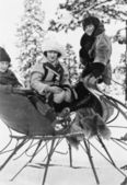 Three women sitting in a sled — Stock Photo