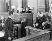Lawyer and a witness in a courtroom — Stock fotografie