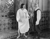 Man in a nightgown arguing with a man in the hallway — Stock Photo