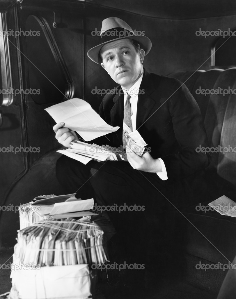 Man in car with bundles of mail — Stock Photo #12290129