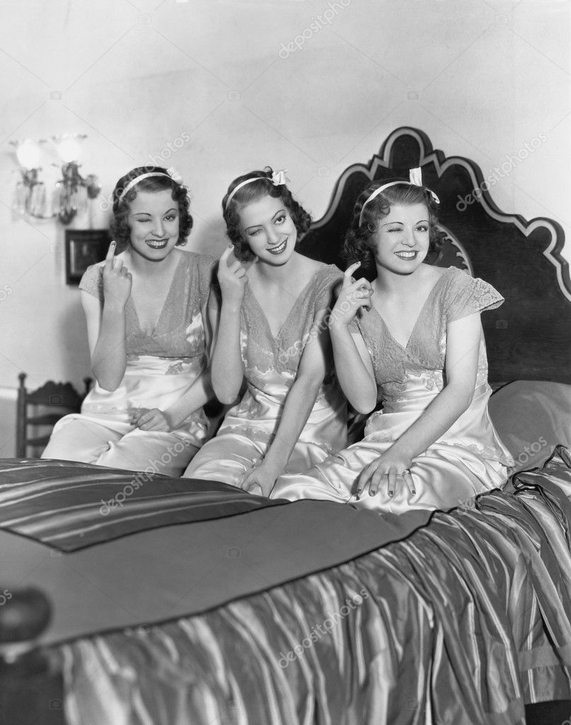 Three young women winking — Stock Photo #12290151
