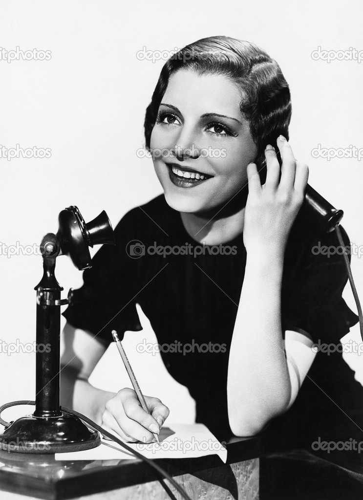 Smiling woman using telephone — Stock Photo #12290842