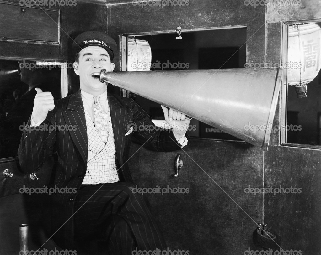 Man with huge megaphone  Stock Photo #12290989