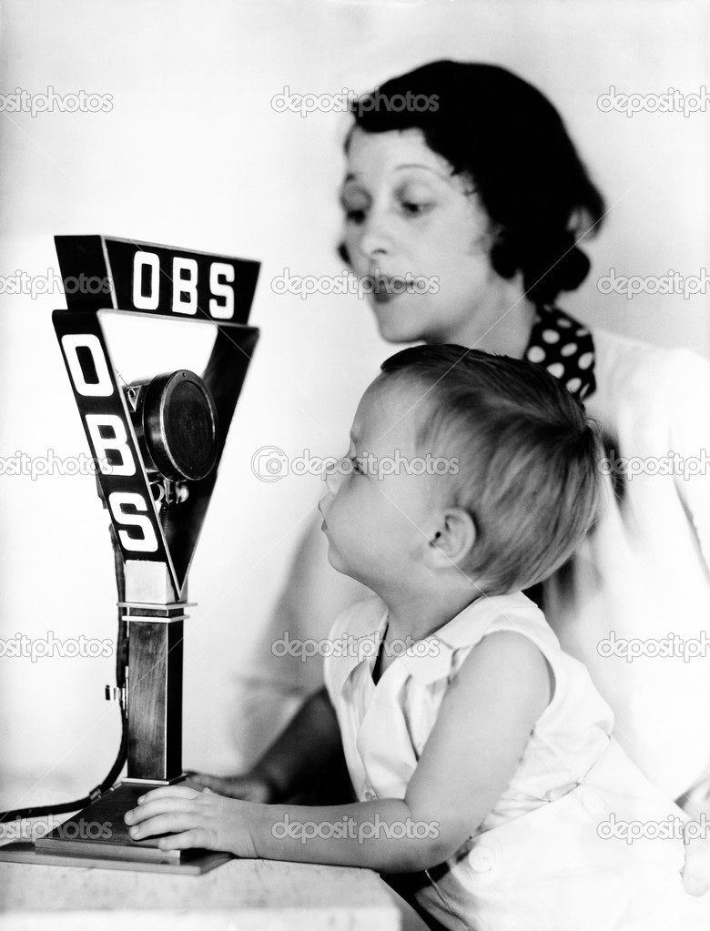 Baby and mother with radio microphone — Stock Photo #12291694