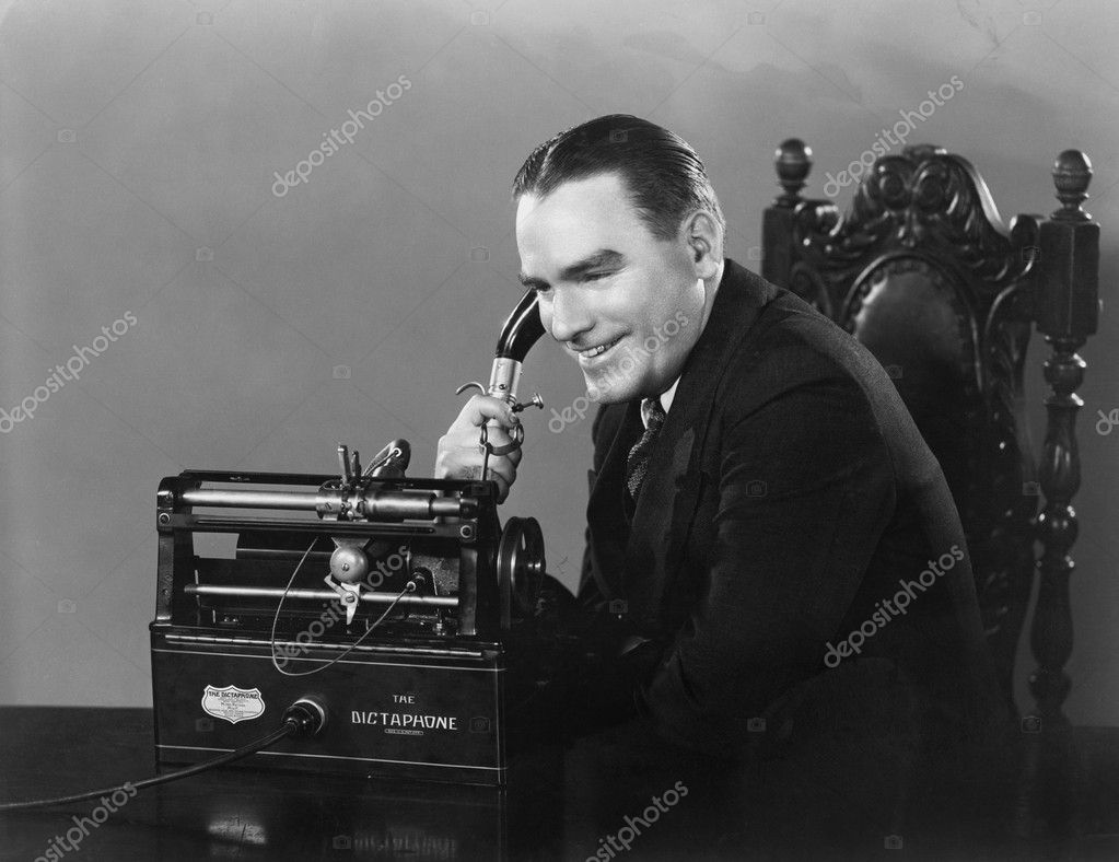 Smiling man using Dictaphone — Stock Photo #12291860