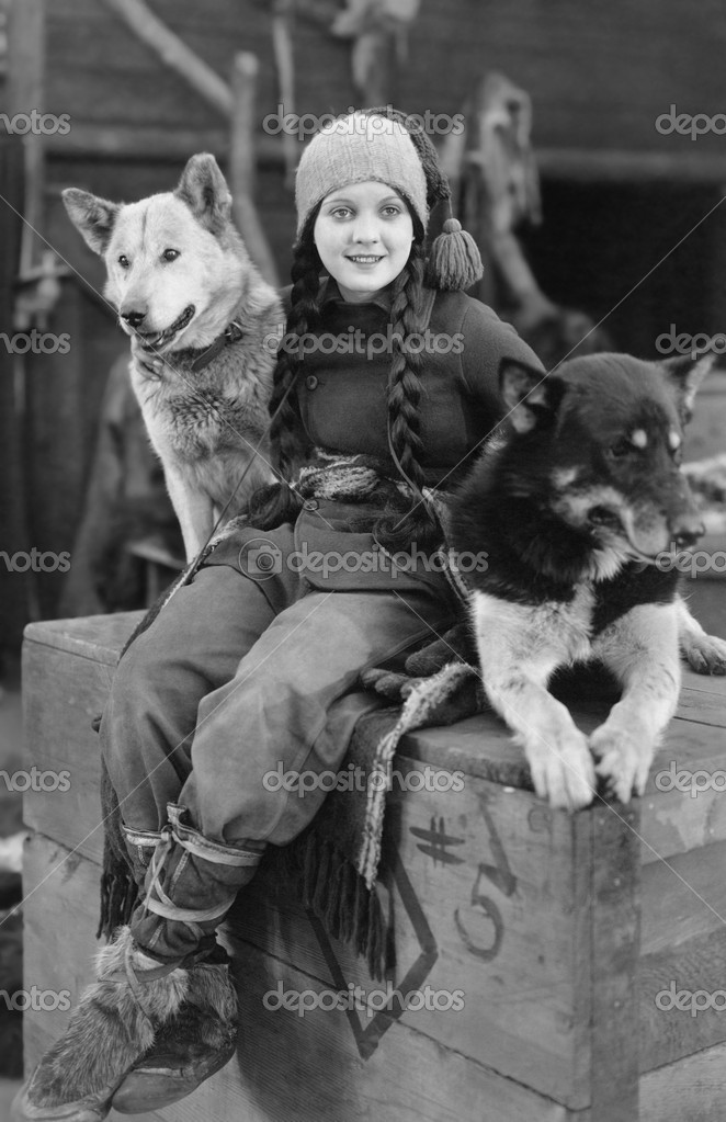 Woman posing with two sled dogs  Stock Photo #12291972