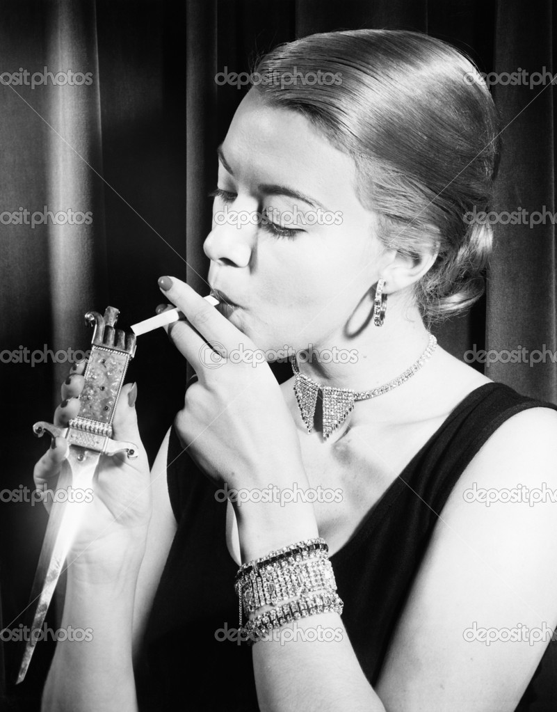 Closeup of woman lighting cigarette — Stock Photo #12292390
