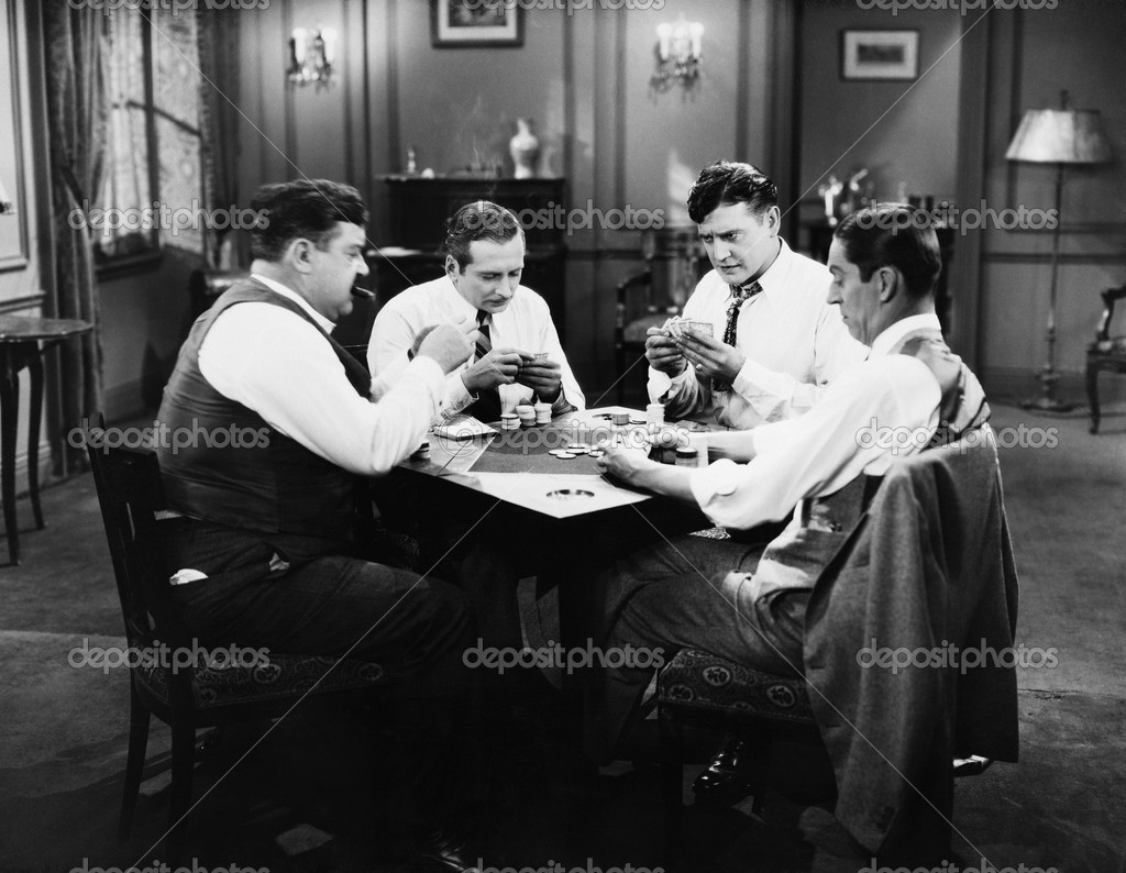 Four men playing cards  Stock Photo #12292791