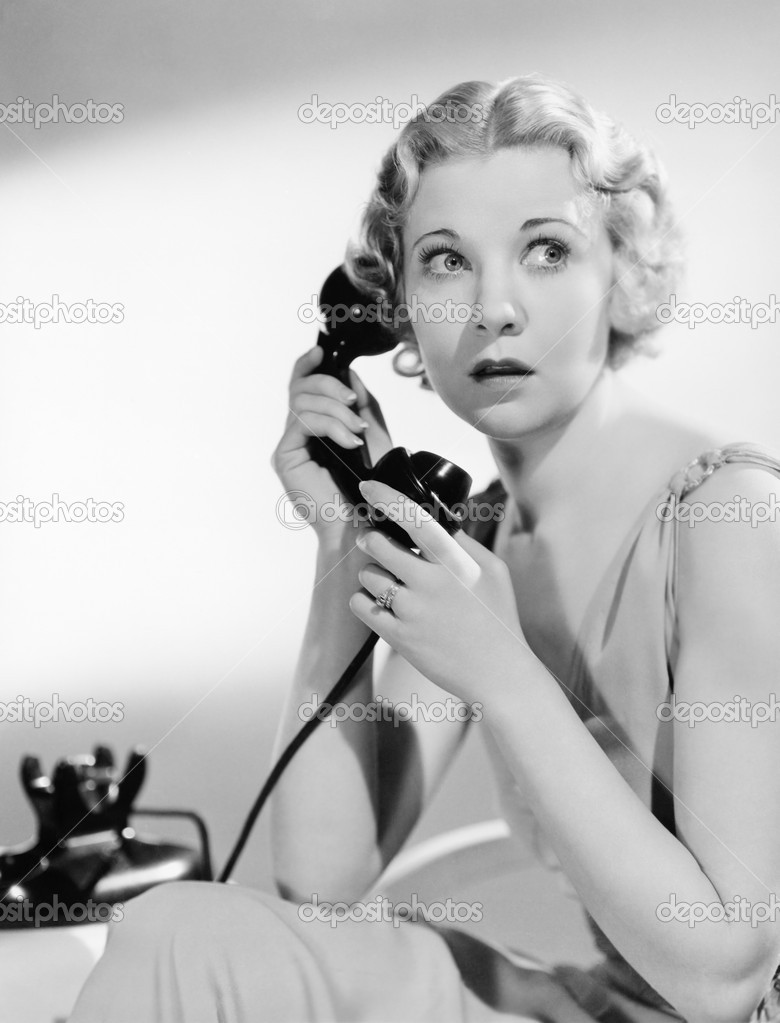 Shocked woman on telephone — Stock Photo #12292957