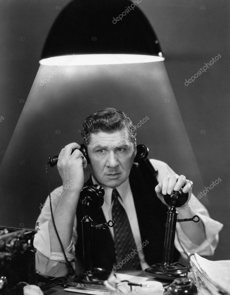 Man using two telephones  Stock Photo #12293158