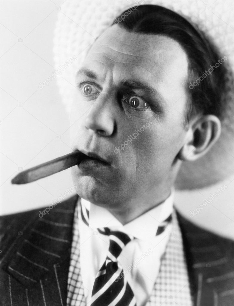 Man with a cigar in his mouth looking surprised — Stock Photo #12293465