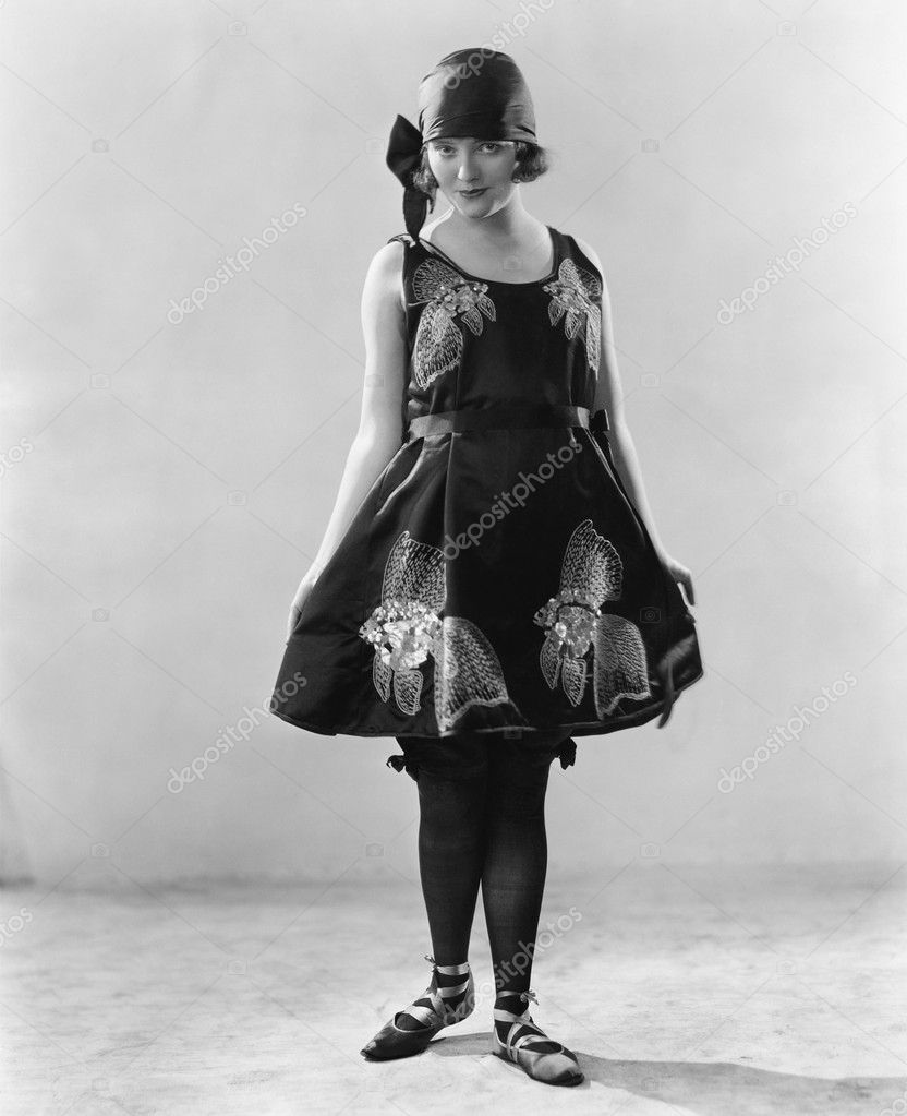 Woman in a flowered dress and ballerina shoes — Photo #12294559