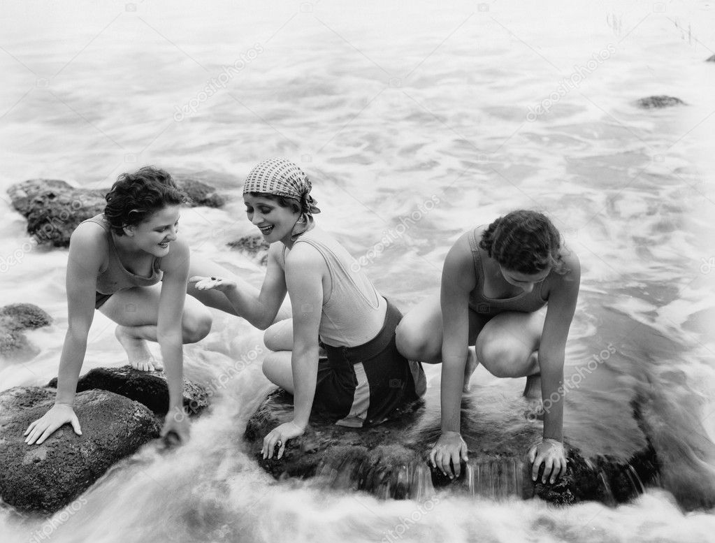 Three women playing in water on the beach — Stok fotoğraf #12294568