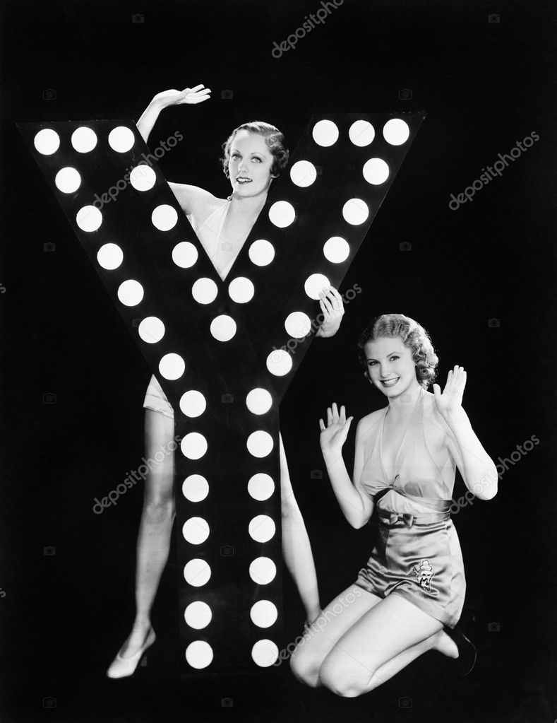 Two young women posing with the letter Y — Foto Stock #12294638