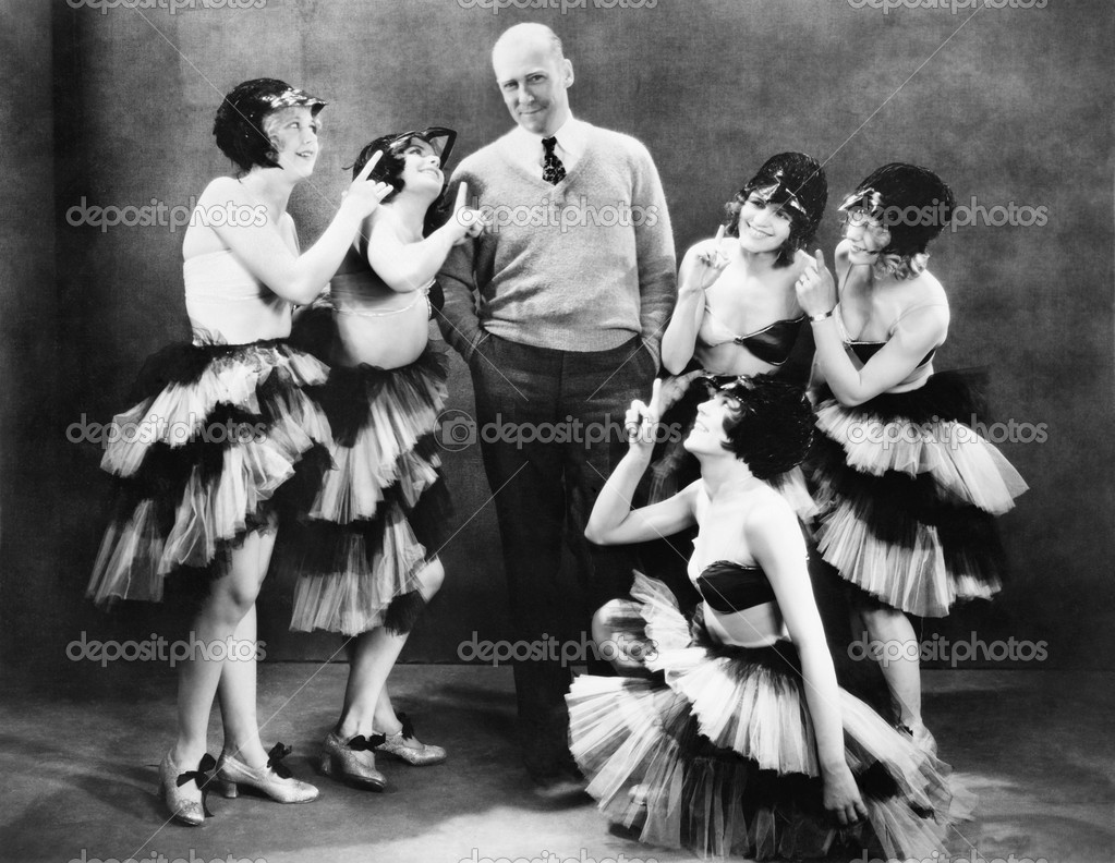 Five young women dancing around a man — Stock Photo #12294645