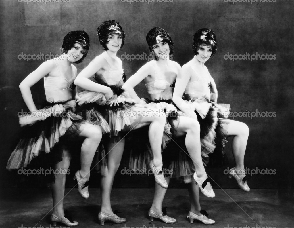 Portrait of four young women performing a dance — Stock Photo #12294650