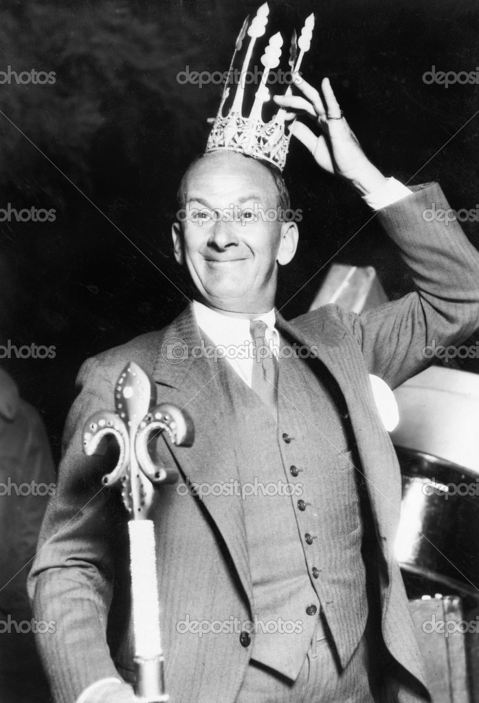 Man with a crown a scepter looking proud — Stockfoto #12298130