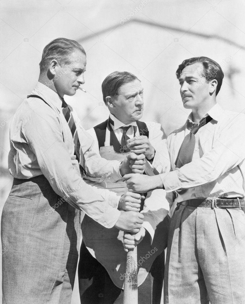 Three men competing who will start first on a baseball bat — Zdjęcie stockowe #12298133