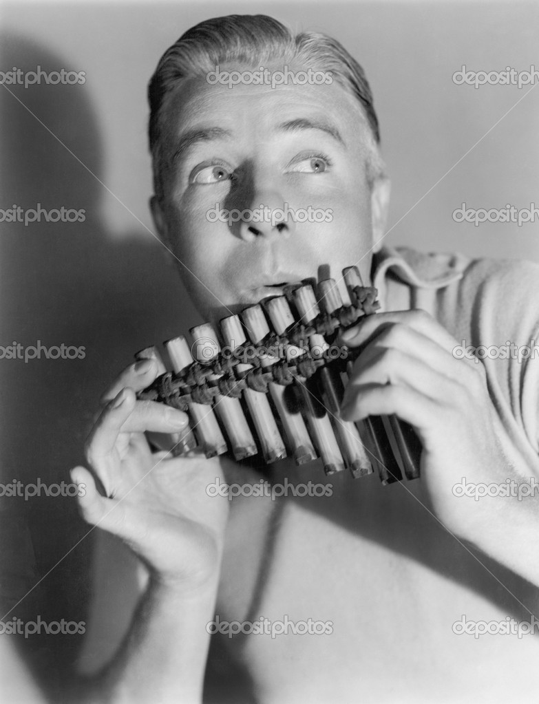 Man playing a pan flute — Stock Photo #12298246