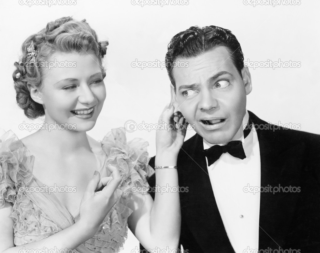 Woman pulling a man's ear — Stock Photo #12298258