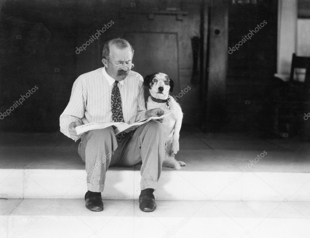 Man and dog sitting on the steps reading the newspaper — Stock Photo #12298319