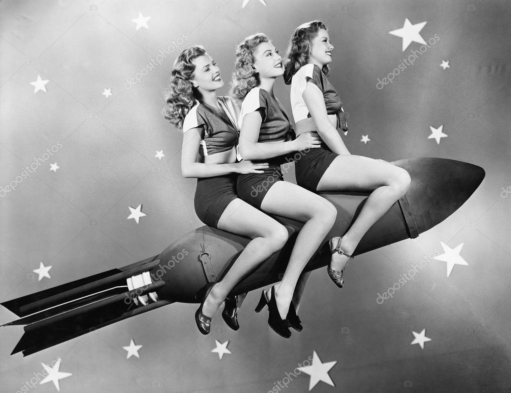 Three women sitting on a rocket  Stock Photo #12299313
