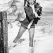 Woman in a Santa costume getting caught on a barbed wire fence — Stok fotoğraf