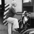 Woman putting gas in the front of her car — Stock Photo