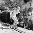 Woman In a bathing suit skiing down a hill — 图库照片