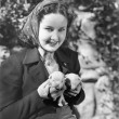 Woman holding two English Bull Terrier puppies - Stockfoto