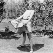 Young woman carrying a basket of laundry - Stockfoto