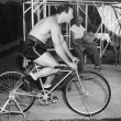 Man sitting on a stationary bicycle doing exercise - 图库照片