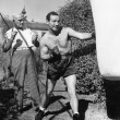 Athlete with his trainer working on a punching bag - 图库照片
