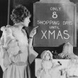 Woman reading sign with number of shopping days until Christmas — Stock Photo