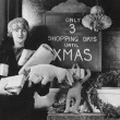 Female shopper and sign with number of shopping days until Christmas - Stok fotoğraf