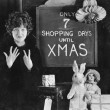 Woman and sign with number of shopping days until Christmas — Stock Photo #12300846