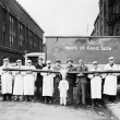Butchers showing off long sausage in front of truck — Stock Photo #12300912