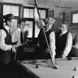 Group of men playing snooker - Stok fotoğraf
