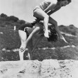 Young women playing leap frog — Photo